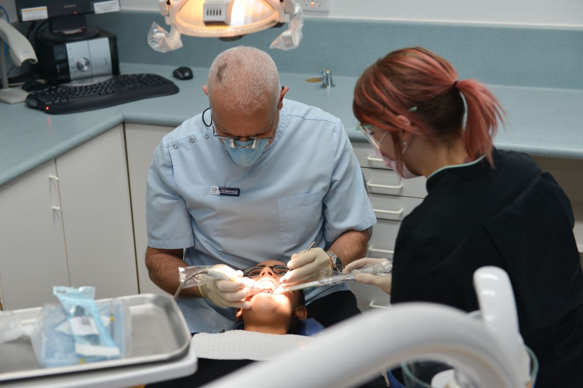 Dentist with patient - Melton Dental Clinic