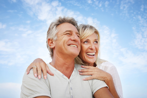 Older couple with dentures smiling